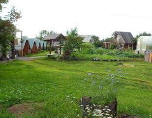 Holzhuetten in Kozyrewsk